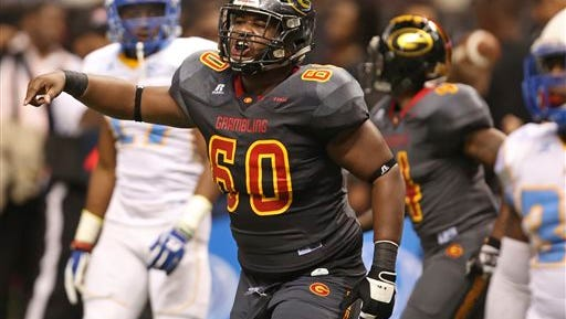 Grambling State offensive lineman Terry Boyd (60) reacts in the second half of the Bayou Classic NCAA college football game against Southern University in New Orleans, Saturday, Nov. 28, 2015.  (AP Photo/Max Becherer)