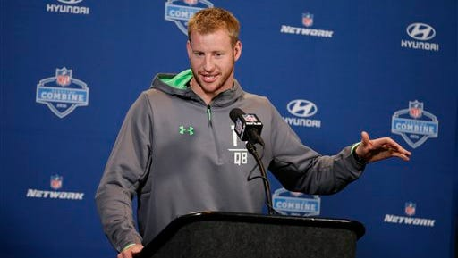 North Dakota St. quarterback Carson Wentz answers a question during the NFL Scouting Combine on Thursday.