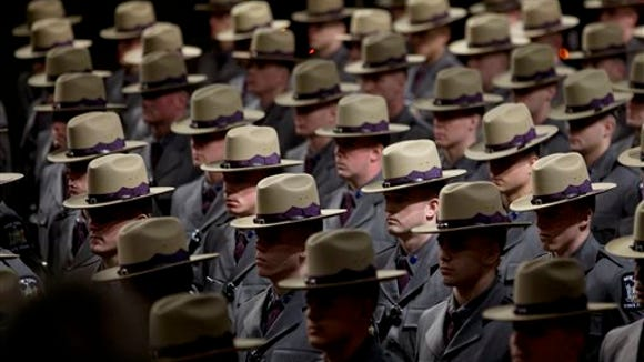 Some of the nearly 230 graduating troopers stand during the New York State Police 202nd session graduation ceremony at the Empire State Plaza Convention Center on Tuesday, Feb. 10, 2015, in Albany.
