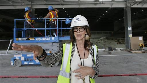 In this photo made Friday, June 3, 2016, Charlotte Jones Anderson, Dallas Cowboys Executive Vice President and Chief Brand Officer, talks about work on the new Dallas Cowboys headquarters in Frisco, Texas. The development, named The Star, will be home to the Cowboys' offices, two outdoor practice fields and a 12,000-seat indoor stadium that will be shared with the Frisco Independent School District. It will include retail shopping and an upscale 16-story hotel with a convention center.