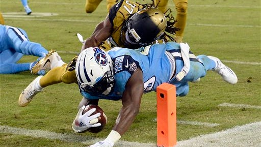 Tennessee Titans running back DeMarco Murray (29) beats Jacksonville Jaguars safety Johnathan Cyprien (37) to the end zone as Murray scores a touchdown on a 14-yard run in the first half.