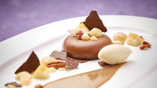 """This March 17, 2017 photo provided by The Culinary Institute of America shows the """"Three Pleasures"""" chocolate-banana panna cotta dessert in Hyde Park, N.Y. This dish is from a recipe by the CIA."""