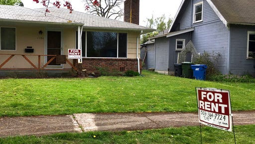 In this April 22, 2017 photo, a for rent signs is displayed in front of a house in Salem, Ore. Droves of people are moving to America's 33rd state, drawn by its natural beauty and job opportunities, but the fast growth has created a housing crisis.