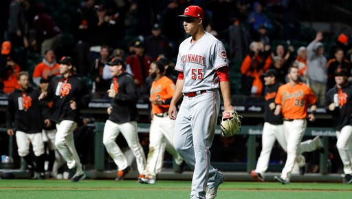 Robert Stephenson walks off the field after Giants catcher Buster Posey's home run in the 17th inning.