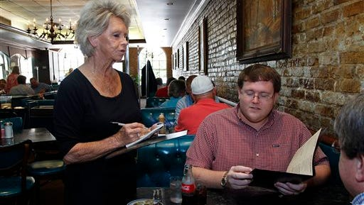 Nina Franklin, a waitress for the Elite restaurant in downtown Jackson  takes an order from first time patron, Seth Starkey. Franklin - a waitress for 20 years - is one of the reasons why the Elite restaurant has remained a staple of downtown Jackson for over six decades.
