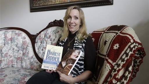 Author Rachel Ann Nunes poses with two versions of her Christian romance novel at her home Tuesday in Orem, Utah. Nunes says a schoolteacher plagiarized her Christian romance novel, added graphic sex scenes and passed it off as her own. In a case she says brings to light plagiarism in the burgeoning world of online self-publishing, Nunes filed a federal lawsuit in August against a Layton, Utah, teacher. Nunes is seeking at least $150,000 in damages as well as attorney's fees in the suit, which was first reported by the Ogden Standard-Examiner.