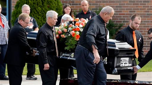 The casket of race car driver Kevin Ward Jr. is taken from a hearse to be carried into South Lewis Central School before a funeral on Thursday in Turin, N.Y. Ward died after being struck by NASCAR driver Tony Stewart's car during a race last weekend at a dirt track in western New York.
