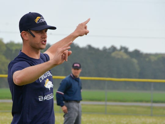 Will Thompson instructs Chincoteague baseball players during a  game  in 2015. He is now the head basketball coach at Nandua High School.