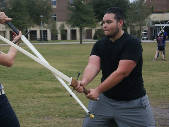 Members of Knight's Blade HEMA at UCF battle.