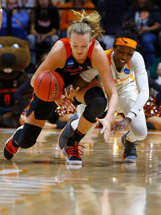 Oregon State guard Mikayla Pivec, left, battles for the ball with Tennessee guard Rennia Davis (0) in the second half of a second-round game in the NCAA college basketball tournament Sunday, March 18, 2018, in Knoxville, Tenn. (AP Photo/Wade Payne)