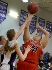 Lexington's Kaylie Grant pulls up for a shot over two TCA defenders during their game Monday.