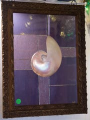 A single glowing shell is the focal point in this $225 piece of stained glass art by Gwen Schroll of Millsboro.