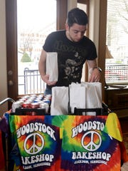 Woodstock Bakeshop manager Gene Gant makes stops downtown with his mobile sack lunch cart to sell items from the restaurant.