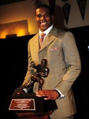 Auburn's Cam Newton wins the 2010 Heisman Trophy on Saturday,  Dec. 11, 2010 in New York, NY. Todd Van Emst/Auburn University
