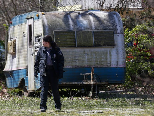 An animal control officer searches the 2600 block of