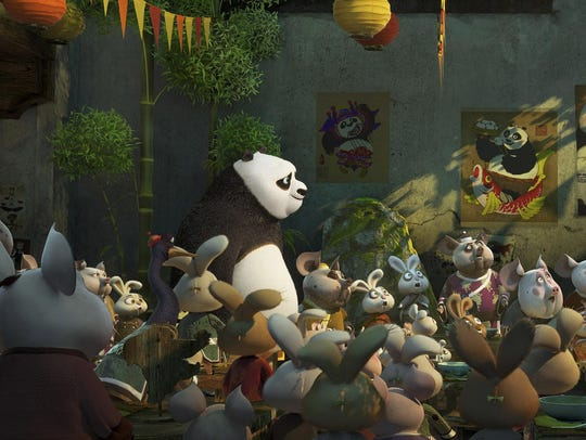 Po (voiced by Jack Black) meets his long-lost panda
