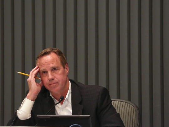 On May 20, 2015, during a council meeting, Palm Springs Mayor Steve Pougnet listens as members of the public question his business ties to developer Richard Meaney and his role in questionable property deals.