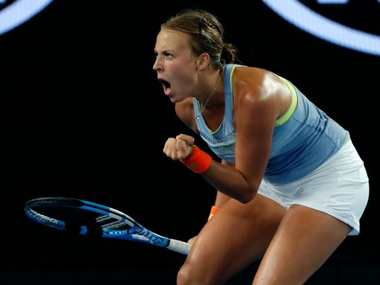 Anett Kontaveit of Estonia reacts after winning a point against Latvia's Jelena Ostapenko during their third round match at the Australian Open tennis championships in Melbourne, Australia, Friday, Jan. 19, 2018. (AP Photo/Vincent Thian)