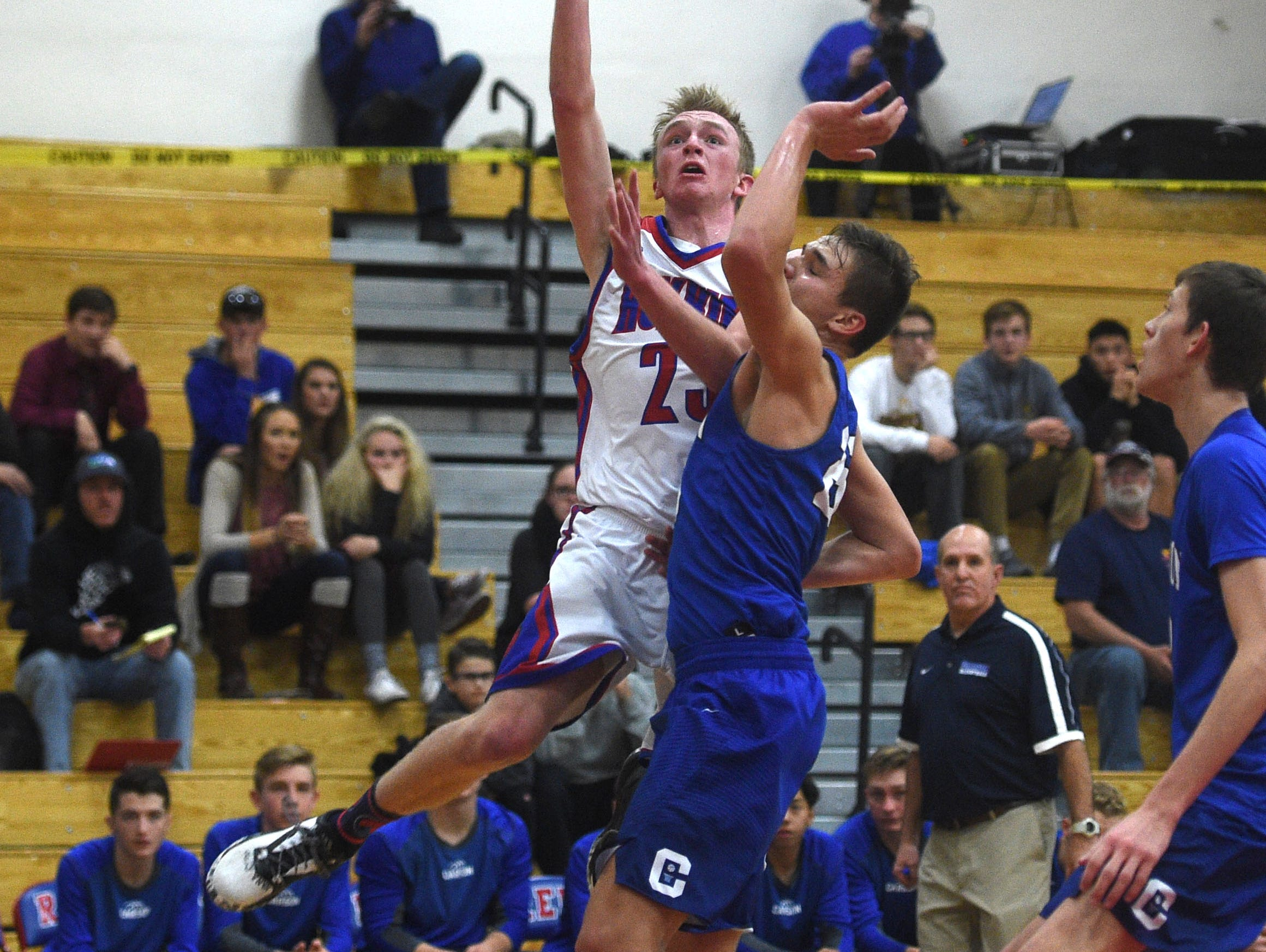 Reno's Drew Rippingham (23) shoots while taking on Carson during their basketball game in Reno on Dec. 23.