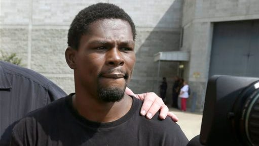 FILE - In this Aug. 27, 2014 file photo, Boxer Jermain Taylor walks from the Pulaski County Jail in Little Rock, Ark. Police say the champion boxer already charged in a shooting at his Arkansas home will face charges in a separate incident after a man said Taylor fired a gun at him. The Little Rock Police Department said Monday, Jan. 19, 2015, that the man told officers responding to a report of shots fired that Taylor also pointed a gun at his wife and children. Authorities say officers took the 36-year-old Taylor into custody and found he had a gun and a small amount of marijuana. (AP Photo/Danny Johnston, File)