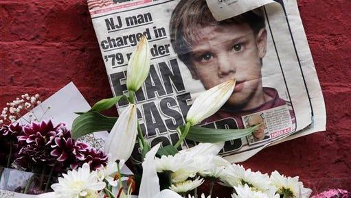 This file photo shows a newspaper with a photograph of Etan Patz at a makeshift memorial in the SoHo neighborhood of New York where Patz lived before his disappearance on May 25, 1979. The memorial was set up near a building that housed a convenience store where Pedro Hernandez, accused of killing Patz, told police 33 years after they boy's disappearance, that he choked the 6-year-old and put the still-living boy into a plastic bag, boxed up the bag and left it on a street. Opening statements in Hernandez's trial are set for Friday.