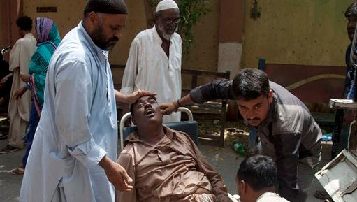 People rush a patient to a hospital suffering from heatstroke in Karachi, Pakistan, on Tuesday, June 23, 2015. A scorching heat wave across southern Pakistan's city of Karachi has killed more than 600 people, authorities said Tuesday, as morgues overflowed with the dead and overwhelmed hospitals struggled to aid those clinging to life.