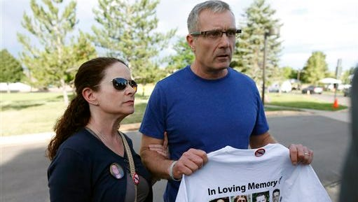 Caren, left, and Tom Teves, who lost their son, Alex, in the 2012 Aurora, Colo., theater massacre, talk to reporters after jurors convicted shooter James Holmes in the killing spree, Thursday, July 16, 2015, in Centennial, Colo. Holmes could get the death penalty for the massacre that left 12 people dead and dozens of others wounded. (AP Photo/David Zalubowski)