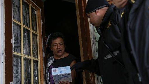 Amado Saldana, Sr., receives a free water filter distributed Friday by the Genesee County Sheriff's Department.