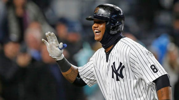 New York Yankees Starlin Castro reacts trotting toward home plate after hitting a second-inning, three-run, home run in a baseball game against the Houston Astros in New York, Wednesday, April 6, 2016.