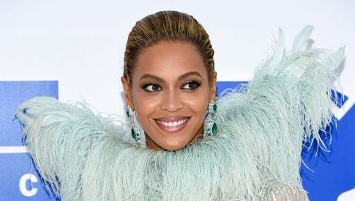 """FILE - In this Aug. 28, 2016 file photo, Beyonce Knowles arrives at the MTV Video Music Awards at Madison Square Garden, in New York. Beyonce performed """"Daddy Lessons,"""" Wednesday, Nov. 2, at the 50th annual CMA Awards in Nashville, Tenn."""
