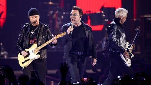 FILE - In this Sept. 23, 2016 file photo, The Edge, from left, Bono and Adam Clayton of the music group U2 performs at the 2016 iHeartRadio Music Festival in Las Vegas.  U2, Red Hot Chili Peppers and The Weeknd are set to headline the annual Bonnaroo Music and Arts Festival in June. Festival organizers announced the 2017 festival lineup on Wednesday, Jan. 11, 2017.