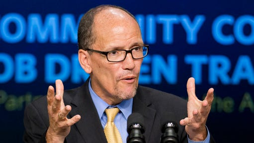 In this Sept. 29, 2014 file photo, then-Labor Secretary Tom Perez speaks in the South Court Auditorium in the White House compound in Washington.