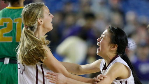 Mercer Island's Kailee Yan, right celebrates with Jackie Stenberg after their team defeated Bishop Blanchet 52-47 in the girls' Class 3A high school basketball championship game, Saturday, March 4, 2017, in Tacoma, Wash. (AP Photo/Ted S. Warren)