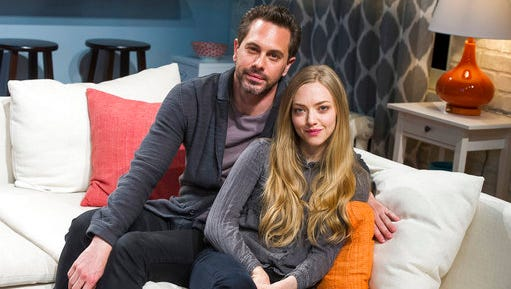 "FILE - In this May 1, 2015, file photo, Thomas Sadoski, left, and Amanda Seyfried pose on the set of Neil LaBute's play ""The Way We Get By"" at the Second Stage Theatre in New York. Sadoski told CBS ""Late Late Show"" host James Corden on March 16, 2017, that he and Seyfried got married on March 12, 2017."