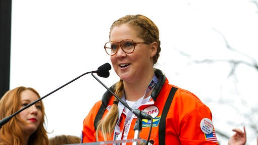 FILE - In this Jan. 21, 2017, file photo, comedian Amy Schumer speaks to the crowd during the Women's March rally in Washington. Variety reported on March 23, 2017, that Schumer dropped out of a live-action big screen version of Barbie due to scheduling conflicts.