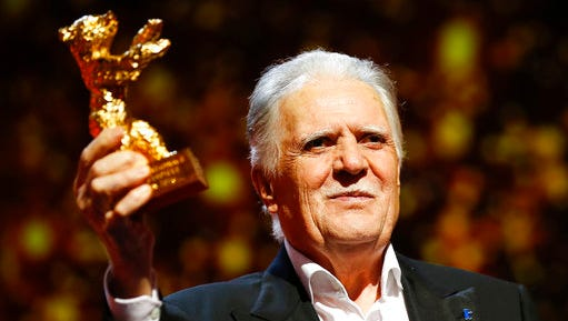 FILE - In this Feb. 18, 2016 file photo German cinematographer Michael Ballhaus shows the Honorary Golden Bear after being awarded for his lifetime achievement during the awarding ceremony at the 2016 Berlinale Film Festival in Berlin, Germany. Ballhaus has died. He was 81.