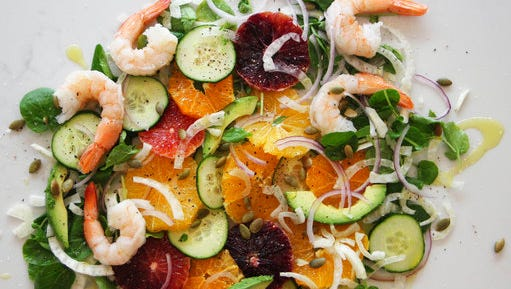 This April 8, 2017 photo shows an orange and cucumber salad with shrimp in Coronado, Calif. This dish is from a recipe by Melissa d'Arabian.