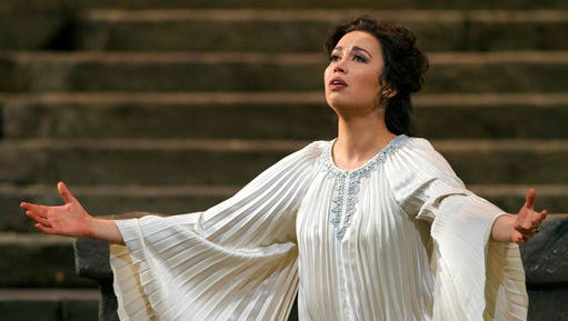 In this March 13, 2017 photo provided by the Metropolitan Opera, Soprano Nadine Sierra performs as Ilia during the final dress rehearsal of Mozart's Idomeneo at the Metropolitan Opera in New York. The 28-year-old Florida native has won the 2017 Richard Tucker Award.
