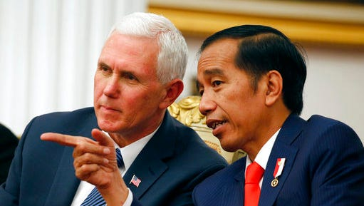 U.S. Vice President Mike Pence, left, talks with Indonesian President Joko Widodo, during their meeting at Merdeka Palace in Jakarta, Indonesia, Thursday, April 20, 2017. Pence is currently on a 10-day trip in Asia.
