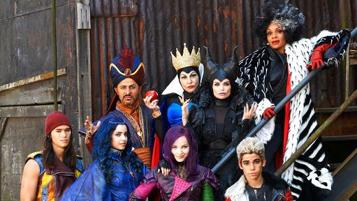 "This image released by the Disney Channel shows cast members of the film, ""Descendants"" stars Booboo Stewart, foreground from left, Sofia Carson, Dove Cameron, Cameron Boyce, and background from left, Maz Jobrani, Kathy Najimy, Kristin Chenoweth and Wendy Raquel Robinson. The Disney Channel is giving a big push to its sequel for the ""Descendants"" movie in July, premiering it simultaneously on five television networks and online. Disney said Tuesday that ""Descendants 2"" will air July 21 on ABC, the Disney Channel, Lifetime, Freeform and Disney XD, as well as on those network's apps. The original movie, about the teen-aged sons and daughters of some famed Disney villains, ranked as the fifth most-watched cable TV movie when it came out two years ago."