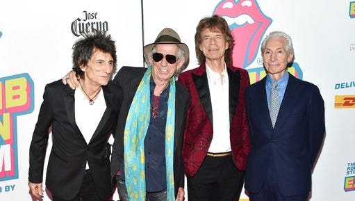 "FILE- In this Nov. 15, 2016, file photo, The Rolling Stones, from left, Ronnie Wood, Keith Richards, Mick Jagger and Charlie Watts attend the opening night party for ""Exhibitionism"" at Industria in New York. Watts received the Gold Award for a lifetime of blues, jazz and rock excellence at Jazz FM's gala in London on Tuesday, April 25, 2017. The Stones also won two awards."