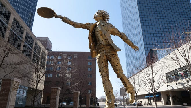 A large sculpture from a previous Art Prize of Albert Einstein titled 'Between Theorems' made by metal sculptor Jim Dolan of Bozeman, MT, remains on display in downtown Grand Rapids on Thursday April 4, 2013.