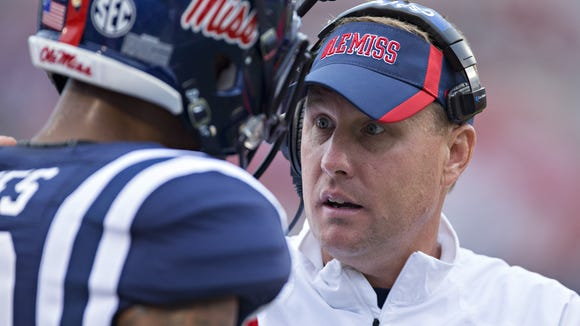 OXFORD, MS - SEPTEMBER 13:  Head Coach Hugh Freeze of the Ole Miss Rebels talks with a player on the sidelines during a game against the Louisiana-Lafayette Ragin' Cajuns at Vaught-Hemingway Stadium on September 13, 2014 in Oxford, Mississippi.  The Rebels defeated the Ragin' Cajuns 56-15.  (Photo by Wesley Hitt/Getty Images)