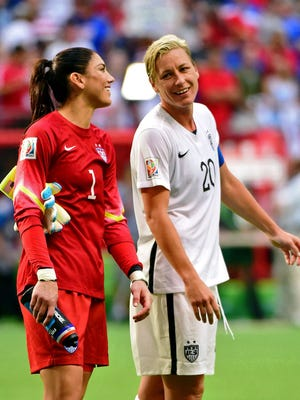 U.S. forward Abby Wambach, right, and goalkeeper Hope Solo have been in the headlines for drama shows at the World Cup in Canada.
