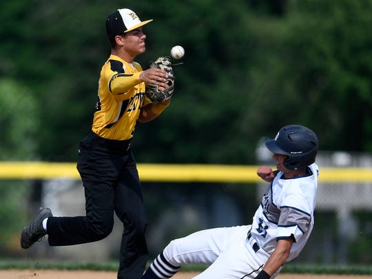 Red Lion shortstop Cole Daugherty completes the double play after getting the force out on Dallastown's Nick Parker during the District 3 Class 6-A baseball semifinal game at Spring Grove, Tuesday, May 29, 2018. John A. Pavoncello photo