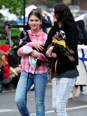 Kids of the human variety carry kids of the goat variety Saturday in the Silverton Pet Parade.