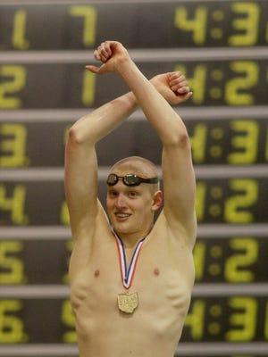 St. Xavier's Grant House reacts in customary fashion after winning a state title in the 500 freestyle on Feb. 27. He and three teammates participated in the Olympic Trials.  St. Xavier junior Grant House reacts in customary fashion after winning a state title in the 500 freestyle on Feb. 27. Grant House Grant House reacts after winning the mens 500 yard freestyle at at the Swimming and Diving Championships in Canton Ohio, Saturday,Feb. 27, 2016. (Photo by Tony Tribble)
