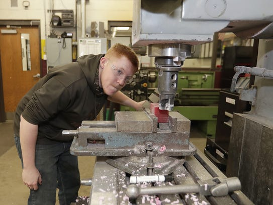 Brandon Jacobs lines up a project on the milling machine Wednesday in the tech ed room at Luxemburg-Casco High School in Luxemburg.