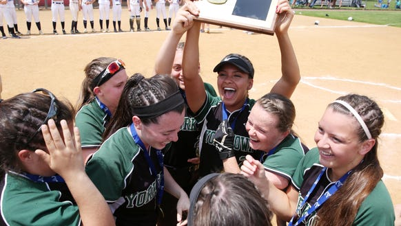 Yorktown players celebrate with the Section 1plaque