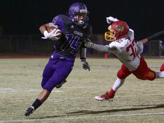 Shadow Hills wide receiver Fernando Cardenas dodges a Hemet defender in Friday night's game.